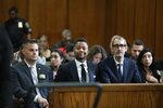 Cuba Gooding Jr., center, appears in court to face new sexual misconduct charges, Tuesday, Oct. 15, 2019, in New York. The new charge involves an alleged incident in October 2018. Gooding Jr. pleaded not guilty. The defense paints it as a shakedown attempt. (Alec Tabak/New York Daily News Pool via AP)