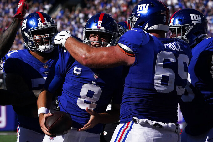 New York Giants quarterback Daniel Jones (8) celebrates after scoring on a two-point conversion during the second half of an NFL football game against the Atlanta Falcons, Sunday, Sept. 26, 2021, in East Rutherford, N.J. (AP Photo/Seth Wenig)