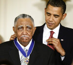 FILE - In this Aug. 12, 2009, file photo, President Barack Obama presents a 2009 Presidential Medal of Freedom to the Rev. Joseph E. Lowery n the East Room of the the White House in Washington. Lowery, a veteran civil rights leader who helped the Rev. Dr. Martin Luther King Jr. found the Southern Christian Leadership Conference and fought against racial discrimination, died Friday, March 27, 2020, a family statement said. He was 98. (AP Photo/J. Scott Applewhite, File)