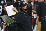 Las Vegas Raiders head coach Jon Gruden reacts during the second half of an NFL football game against the Los Angeles Chargers, Thursday, Dec. 17, 2020, in Las Vegas. (AP Photo/Isaac Brekken)