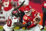 Kansas City Chiefs quarterback Patrick Mahomes breaks away from Tampa Bay Buccaneers outside linebacker Jason Pierre-Paul during the second half of the NFL Super Bowl 55 football game Sunday, Feb. 7, 2021, in Tampa, Fla. (AP Photo/Ashley Landis)