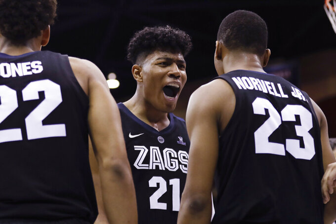 Gonzaga forward Rui Hachimura (21) reacts with teammates during the second half of an NCAA college basketball game against San Diego, Saturday, Feb. 16, 2019, in San Diego. (AP Photo/Gregory Bull)
