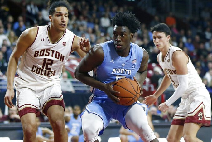 North Carolina's Nassir Little (5) drives to the basket against Boston College's Johncarlos Reyes (12) during the second half of an NCAA college basketball game in Boston, Tuesday, March 5, 2019. (AP Photo/Michael Dwyer)