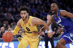 FILE - In this Friday, March 15, 2019, file photo, Marquette guard Markus Howard (0) drives past Seton Hall guard Quincy McKnight (0) during the first half of an NCAA college basketball in the Big East Conference tournament in New York. Murray State point guard Ja Morant is future NBA lottery pick. Marquette point guard Markus Howard is the Big East player of the year. Two of the top-10 scorers in the country meet in a 5-12 NCAA Tournament game in the West Region. (AP Photo/Julio Cortez, File)