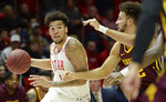 Utah forward Timmy Allen (1) moves past Minnesota guard Gabe Kalscheur (22) during an NCAA college basketball game Friday, Nov. 15, 2019, in Salt Lake City. (Francisco Kjolseth/The Salt Lake Tribune via AP)