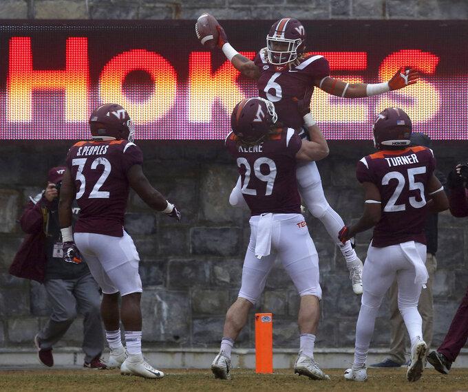Tech receiver Hezekiah Grimsley (6) of Virginia Tech celebrates a 46 yard touchdown play in the first quarter  of an NCAA college football game in Blacksburg Va. Saturday, Dec. 1 2018. (Matt Gentry/The Roanoke Times via AP)