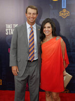 Clemson head coach Dabo Swinney and his wife Kathleen Bassett, walk the red carpet ahead of the first round at the NFL football draft, Thursday, April 25, 2019, in Nashville, Tenn. (AP Photo/Mark Humphrey)