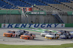 Drives run at the start of a NASCAR Truck Series race Saturday, July 11, 2020, in Sparta, Ky. (AP Photo/Mark Humphrey)