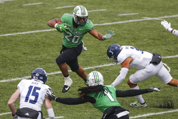 Marshall running back Brenden Knox (20) rushes upfield on a carry during an NCAA college football game against Rice on Saturday, Dec. 5, 2020, in Huntington, W.Va.  (Sholten Singer/The Herald-Dispatch via AP)