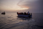 Migrants on an overcrowded wooden boat wait to be rescued in the Mediterranean Sea, Thursday, Sept. 19, 2019. The Ocean Viking, jointly operated by SOS Mediterranee and Doctors Without Borders, rescued 36 people from the small wooden boat after being requested to do so by Maltese authorities. (AP Photo/Renata Brito)