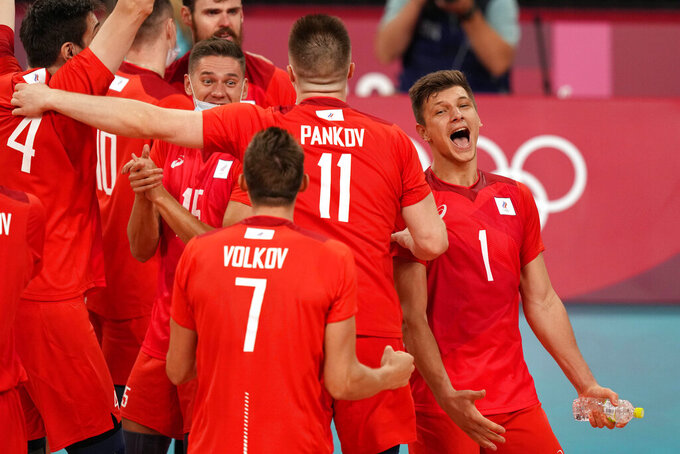 Russian players celebrate winning the men's volleyball semifinal match between Brazil and Russian Olympic Committee at the 2020 Summer Olympics, Thursday, Aug. 5, 2021, in Tokyo, Japan. (AP Photo/Frank Augstein)