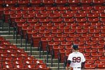 Boston Red Sox's Alex Verdugo watches as the ground-rule double by Tampa Bay Rays' Brandon Lowe goes into the empty stands during the seventh inning of a baseball game, Tuesday, Aug. 11, 2020, in Boston. (AP Photo/Michael Dwyer)