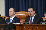 Ranking member Rep. Devin Nunes, R-Calif., right, and House Intelligence Committee Chairman Adam Schiff, D-Calif., left, give opening remarks at the start of the hearing with former U.S. Ambassador to Ukraine Marie Yovanovitch before the House Intelligence Committee on Capitol Hill in Washington, Friday, Nov. 15, 2019, in the second public impeachment hearing of President Donald Trump's efforts to tie U.S. aid for Ukraine to investigations of his political opponents. (AP Photo/Susan Walsh)