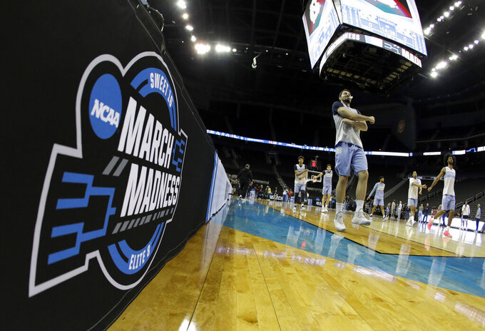 North Carolina players warm up before practice for the NCAA men's college basketball tournament Thursday, March 28, 2019, in Kansas City, Mo. North Carolina plays Auburn in a Midwest Regional semifinal game on Friday. (AP Photo/Charlie Riedel)