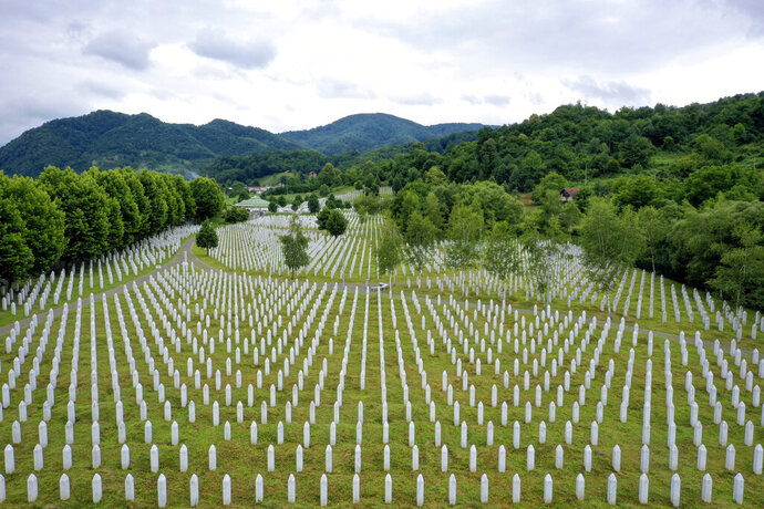 Gravestones are lined up at the memorial cemetery in Potocari, near Srebrenica, Bosnia, Tuesday, July 7, 2020. A quarter of a century after they were killed in Sreberenica, eight Bosnian men and boys will be laid to rest Saturday, July 11. Over 8,000 Bosnian Muslims perished in 10 days of slaughter after the town was overrun by Bosnian Serb forces in the closing months of the country's 1992-95 fratricidal war. (AP Photo/Kemal Softic)