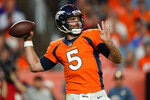 FILE - In this Oct. 17, 2019, file photo, Denver Broncos quarterback Joe Flacco (5) throws against the Kansas City Chiefs during the first half of an NFL football game in Denver.  A person with knowledge of the move tells The Associated Press that the Denver Broncos are waiving Joe Flacco with a failed physical designation, putting another veteran NFL quarterback on the open market. The person spoke on condition of anonymity because the team didn't announce the decision. (AP Photo/Jack Dempsey, File)
