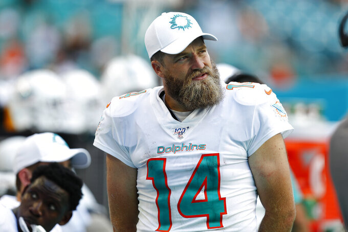 Miami Dolphins quarterback Ryan Fitzpatrick (14) walks the sidelines at the end of the second half at an NFL football game, Sunday, Sept. 8, 2019, in Miami Gardens, Fla. The Ravens defeated the Dolphins 59-10. (AP Photo/Brynn Anderson)