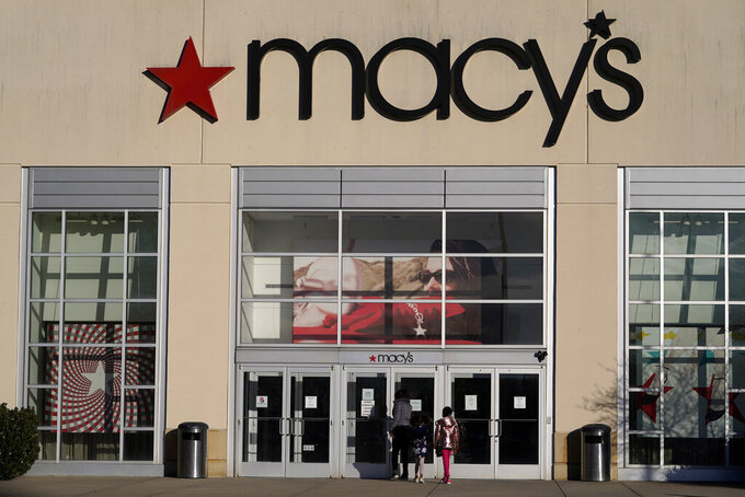 FILE - In this Feb. 22, 2021 file photo, shoppers arrive at a Macy's in Charlotte, N.C. Macy's emerged from an unprecedented year by swinging to a profit and it upped its expectations for the year. The retailer on Tuesday, May 18, 2021, posted net income of $103 million, after reporting a loss in the same period a year earlier. (AP Photo/Chris Carlson, File)