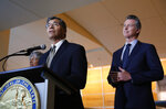 California Attorney General Xavier Becerra, left, flanked by California Gov. Gavin Newsom, right, discusses the lawsuit the state has joined in with 21 other Democrat-led states against the Trump administration over its decision to ease restrictions on coal-fired power plants during a news conference in Sacramento, Calif., Tuesday, Aug. 13, 2019. (AP Photo/Rich Pedroncelli)