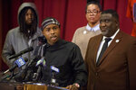 Stevante Clark, the brother of Stephon Clark who was killed by police last year, speaks during a news conference at the Genesis Church in Sacramento, Calif., Sunday, March 3, 2019. Accompanying Clark are his brother Jhailen Clark, left, National Action Network representative Margaret Fortune, and Tecoy Porter Sr., pastor at the Genesis Church. Clark's comments followed Saturday's announcement by Sacramento District Attorney Anne Marie Schubert that the two officers who shot and killed Stephon Clark will not be charged in the shooting. (AP Photo/Randall Benton)