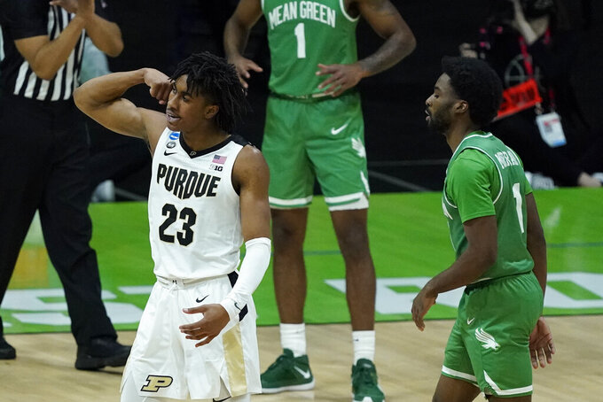 Purdue's Jaden Ivey (23) reacts in front of North Texas's JJ Murray (11) after Ivey hit a shot and was fouled during the second half of a first-round game in the NCAA men's college basketball tournament at Lucas Oil Stadium, Friday, March 19, 2021, in Indianapolis. (AP Photo/Darron Cummings)