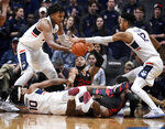 Connecticut's Josh Carlton, left, Houston's Galen Robinson Jr., center, and Connecticut's Tyler Polley, right, reach for the ball as Connecticut's Brendan Adams, bottom left, and Houston's Corey Davis Jr., bottom, right, are tangled together during the first half of an NCAA college basketball game, Thursday, Feb. 14, 2019, in Hartford, Conn. (AP Photo/Jessica Hill)