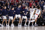 The Gonzaga bench reacts after guard Admon Gilder (1) dunked during the second half of the team's NCAA college basketball game against BYU in Spokane, Wash., Saturday, Jan. 18, 2020. Gonzaga won 92-69. (AP Photo/Young Kwak)