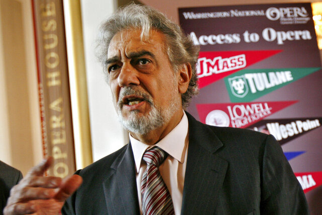 FILE - In this May 23, 2007, file photo, Placido Domingo, general director of the Washington National Opera, speaks during a news conference in Washington about a simulcast of a performance of La Boheme. An investigation into Domingo by the U.S. union representing opera performers found more than two dozen people who said they were sexually harassed or witnessed inappropriate behavior by the superstar when he held senior management positions at Washington National Opera and Los Angeles Opera, according to people familiar with the findings. (AP Photo/Jacquelyn Martin, File)