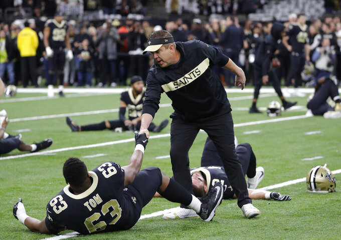 New Orleans Saints head coach Sean Payton watches as players warm up before the NFL football NFC championship game against the Los Angeles Rams Sunday, Jan. 20, 2019, in New Orleans. (AP Photo/John Bazemore)