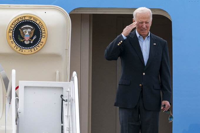 President Joe Biden salutes as he boards Air Force One upon departure, Wednesday, June 9, 2021, at Andrews Air Force Base, Md. Biden is embarking on the first overseas trip of his term, and is eager to reassert the United States on the world stage, steadying European allies deeply shaken by his predecessor and pushing democracy as the only bulwark to the rising forces of authoritarianism. (AP Photo/Alex Brandon)