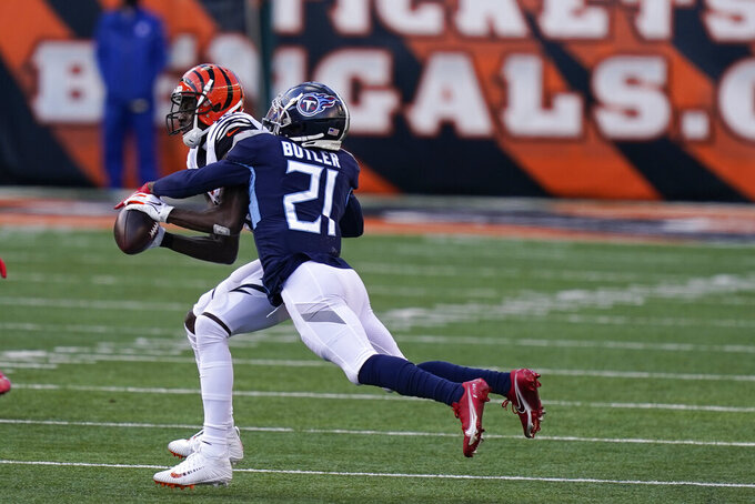 Cincinnati Bengals' A.J. Green (18) makes a catch against Tennessee Titans' Malcolm Butler (21) during the second half of an NFL football game, Sunday, Nov. 1, 2020, in Cincinnati. (AP Photo/Bryan Woolston)