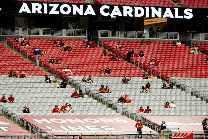 Fans watch during the first half of an NFL football game between the Detroit Lions and the Arizona Cardinals, Sunday, Sept. 27, 2020, in Glendale, Ariz. (AP Photo/Rick Scuteri)