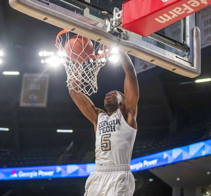 Georgia Tech forward Moses Wright (5) dunks against Florida A&M during the first half of an NCAA college basketball game in Atlanta, Friday, Dec. 18, 2020. (Alyssa Pointer/Atlanta Journal-Constitution via AP)