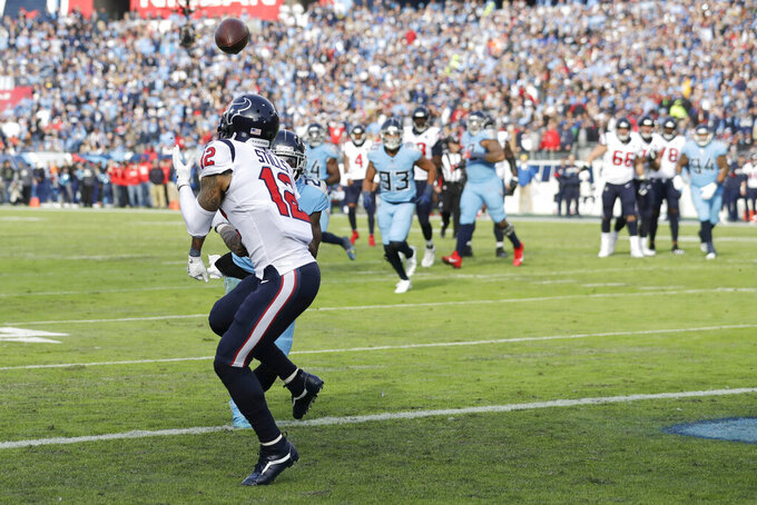 Houston Texans wide receiver Kenny Stills (12) catches a 16-yard touchdown pass against the Tennessee Titans in the first half of an NFL football game Sunday, Dec. 15, 2019, in Nashville, Tenn. (AP Photo/James Kenney)
