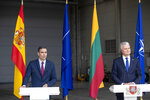 Lithuania's President Gitanas Nauseda and Spain's Prime Minister Pedro Sanchez, left, answers questions during a meeting with the press at the Siauliai military air force base some 220 kms (136,7 miles) east of the capital Vilnius, Lithuania, Thursday, July 8, 2021. (AP Photo/Mindaugas Kulbis)