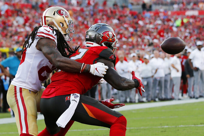 Tampa Bay Buccaneers wide receiver Chris Godwin (12) prepares to make a touchdownn catch in the end zone against San Francisco 49ers cornerback Richard Sherman (25) during the second half an NFL football game, Sunday, Sept. 8, 2019, in Tampa, Fla. (AP Photo/Mark LoMoglio)