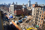 FILE - In this April 2, 2015 file photo, investigators continue work in a debris site remaining from a building explosion and ensuing fire that destroyed three buildings in the East Village neighborhood of New York. Three people were convicted of manslaughter, Friday, Nov. 15, 2019, in the 2015 East Village building explosion that killed two men. (AP Photo/Bebeto Matthews, File)