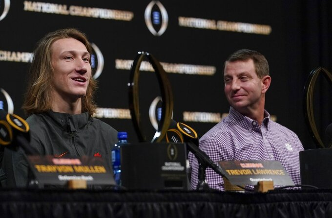Clemson head coach Dabo Swinney and Trevor Lawrence answer questions at a news conference for the NCAA college football playoff championship game Tuesday, Jan. 8, 2019, in San Jose, Calif. (AP Photo/Morry Gash)