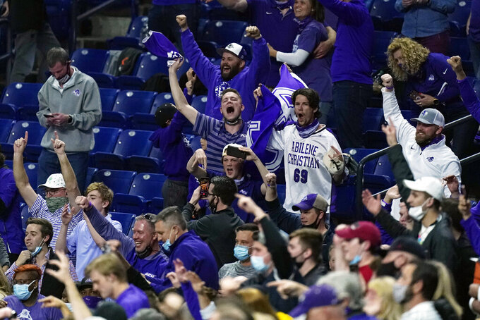 Abilene Christian fans celebrate after Abilene Christian upset Texas in a college basketball game in the first round of the NCAA tournament at Lucas Oil Stadium in Indianapolis Sunday, March 21, 2021. (AP Photo/Mark Humphrey)