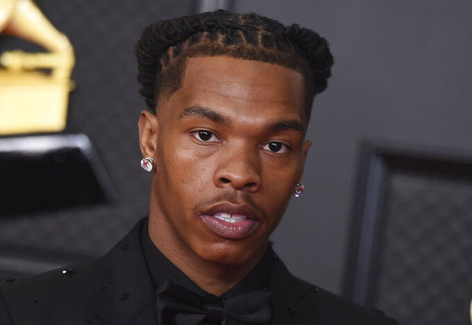 FILE - In this March 14, 2021, file photo, Lil Baby poses in the press room at the 63rd annual Grammy Awards at the Los Angeles Convention Center in Los Angeles. The rapper was detained in Paris on Thursday, July 8, for allegedly transporting drugs, according to the city prosecutor's office. NBA star James Harden was also stopped but not detained, the prosecutor's office said. The prosecutor's office said one other person was also detained, without releasing the identity. An investigation is under way. (Photo by Jordan Strauss/Invision/AP, File)
