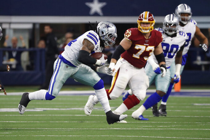 Dallas Cowboys middle linebacker Jaylon Smith (54) advances the ball after an interception against the Washington Redskins during the first half of an NFL football game in Arlington, Texas, Sunday, Dec. 15, 2019. (AP Photo/Roger Steinman)