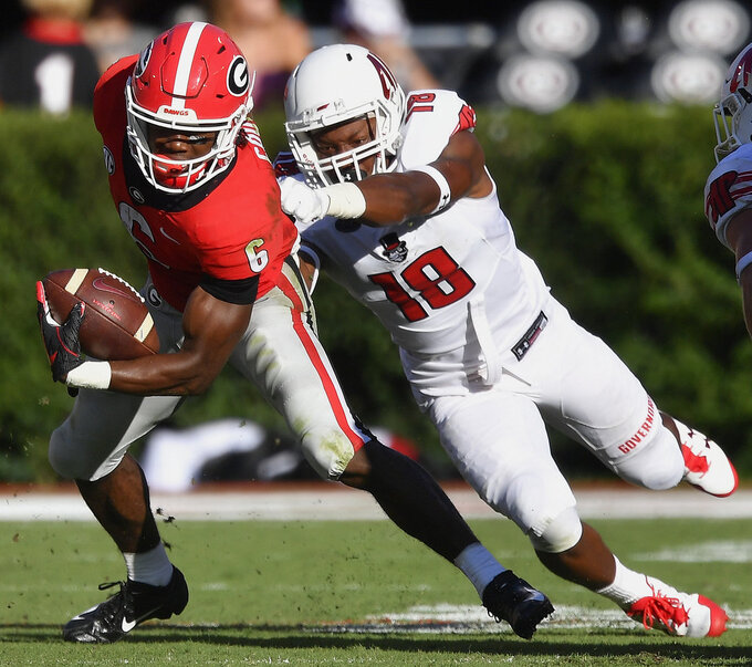 Georgia running back James Cook (6) runs against Austin Peay linebacker Elijah Shepard (18) during the second half of an NCAA college football game, Saturday, Sept. 1, 2018, in Athens, Ga. (AP Photo/Mike Stewart)