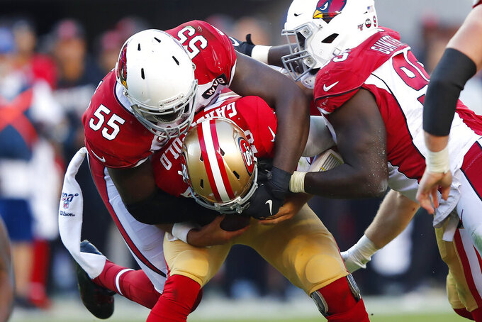 Arizona Cardinals linebacker Chandler Jones (55) sacks San Francisco 49ers quarterback Jimmy Garoppolo during the second half of an NFL football game in Santa Clara, Calif., Sunday, Nov. 17, 2019. At right is defensive tackle Rodney Gunter. (AP Photo/John Hefti)