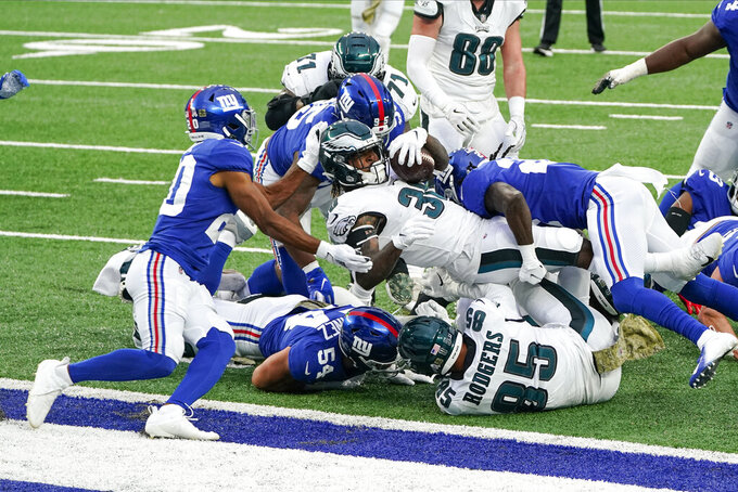 Philadelphia Eagles' Corey Clement (30) rushes for a touchdown during the second half of an NFL football game against the New York Giants, Sunday, Nov. 15, 2020, in East Rutherford, N.J. (AP Photo/Seth Wenig)