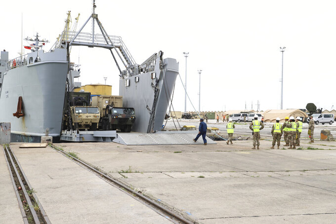 U.S. army vehicles disembark from a vessel at Albania's main port of Durres, Saturday, May 1, 2021.  Florida National Guard's 53rd Infantry Brigade Combat Team were being discharged from the USNS Bob Hope ahead of a two-week training of up to 6,000 U.S. troops in six Albanian military bases, as part of the Defender-Europe 21 large-scale U.S. Army-led exercise. (AP Photo/Hektor Pustina)