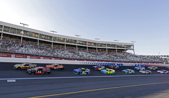 Daniel Hemric (8) and Michael McDowell (34) lead the field out of Turn 4 for the start of the NASCAR All-Star Open auto race at Charlotte Motor Speedway in Concord, N.C., Saturday, May 18, 2019. (AP Photo/Chuck Burton)