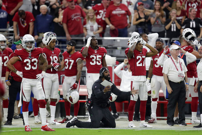 The Arizona Cardinals bench reacts to a dropped interception during overtime of an NFL football game against the Detroit Lions, Sunday, Sept. 8, 2019, in Glendale, Ariz. The Lions and Cardinals played to a 27-27 tie in overtime. (AP Photo/Darryl Webb)