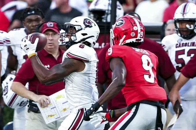 South Carolina wide receiver Josh Vann (6) catches a pass next to Georgia defensive back Ameer Speed (9) during the first half of an NCAA college football game Saturday, Sept. 18, 2021, in Athens, Ga. (AP Photo/Butch Dill)