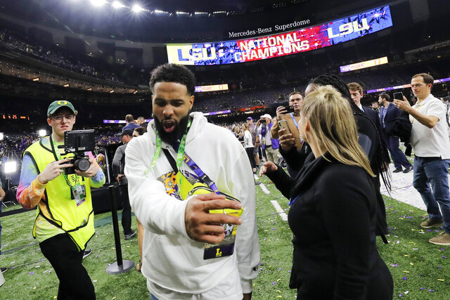 FILE - In this Tuesday, Jan. 14, 2020 photo, Cleveland Browns wide receiver and former LSU star Odell Beckham Jr. walks off the field after the NCAA College Football Playoff national championship game between Clemson and LSU in New Orleans. The New Orleans Police Department said Saturday, Jan 18, 2020, that a misdemeanor simple battery warrant for Beckham has been rescinded. (AP Photo/Gerald Herbert, File)