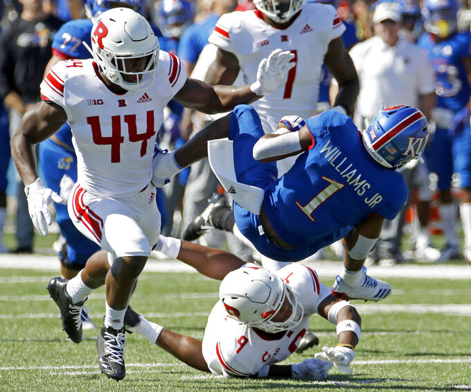 Kansas running back Pooka Williams Jr. (1) is tackled by Rutgers linebacker Tyreek Maddox-Williams (44) during the first half of an NCAA college football game Saturday, Sept. 15, 2018, in Lawrence, Kan. (AP Photo/Charlie Riedel)